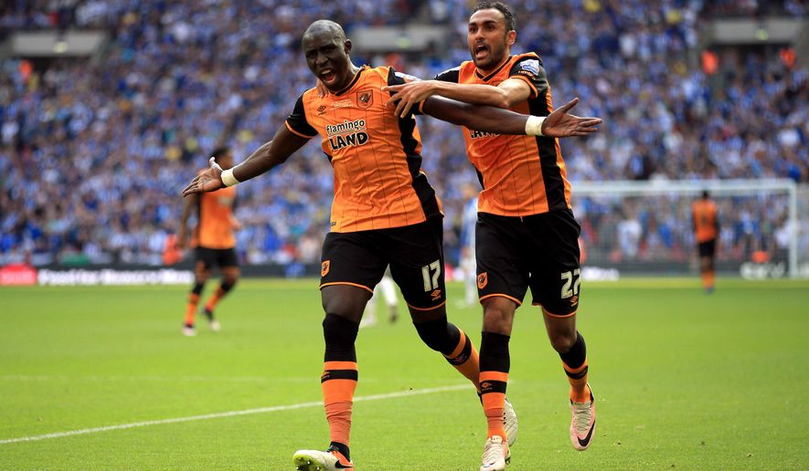 Hull City's Mohamed Diame, left, celebrates scoring his side's first goal of the game with teammate Ahmed Elmohamady during the Championship play-off soccer final against Sheffield Wednesday at Wembley Stadium, London, Saturday, May 28, 2016. Hull secured an immediate return to the English Premier League and a minimum $250 million cash bonanza by beating Sheffield Wednesday 1-0 in the League Championship playoff final on Saturday. (Nick Potts/PA via AP)       UNITED KINGDOM OUT      -    NO SALES      -     NO ARCHIVES