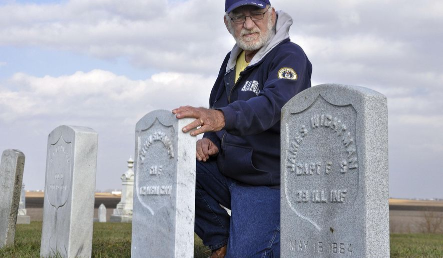 "In this Nov. 15, 2015 photo, Harold Schook an Air Force veteran who every year at this time plants small American flags near area veterans' graves examines five new Civil War-era gravestones belonging to soldiers at the Odell Township Cemetery in Odell, Ill. High school students in Odell discovered the names of several Civil War veterans whose gravestones were battered by decades of rain, wind, snow and pollution and were replaced with new ones. ""These kids gave these men their identity back,"" said Schook. (Joy Butler/Pontiac Daily Leader via AP)"