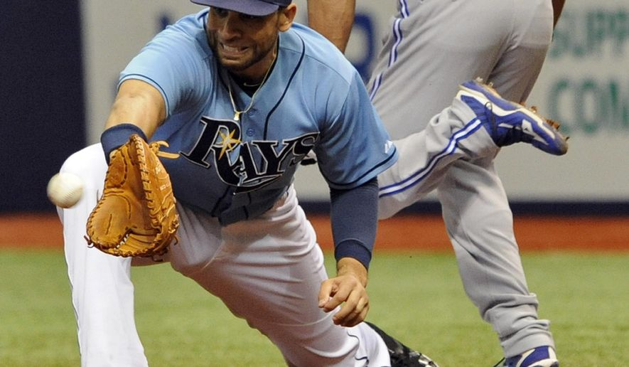 FILE - In this Oct. 4, 2015, file photo, Tampa Bay Rays first baseman James Loney reaches for the late throw as Toronto Blue Jays' Ben Revere is safe with an infield base hit during the first inning of a baseball game in St. Petersburg, Fla. The New York Mets have found help at first base following Lucas Duda's injury, acquiring veteran James Loney from the San Diego Padres for cash on Saturday, May 28, 2016.  The 32-year-old Loney hit .280 with four homers, 16 doubles and 32 RBIs in 104 games with Tampa Bay last year. The Rays released him April 3 and he signed with the Padres on April 8.  (AP Photo/Steve Nesius, File))