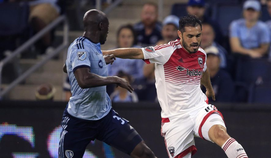 D.C. United forward Fabian Espindola, right, is challenged by Sporting Kansas City defender Ike Opara (3) during the first half of an MLS soccer match in Kansas City, Kan., Friday, May 27, 2016. (AP Photo/Orlin Wagner) **FILE**