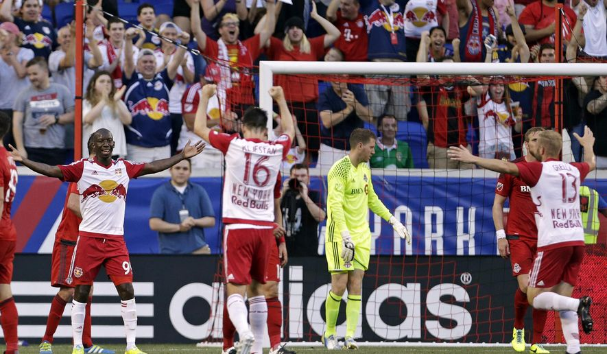 New York Red Bulls forward Bradley Wright-Phillips, left, celebrates after scoring his second goal of the first half against Toronto FC goalkeeper Clint Irwin, third from right, during an MLS soccer game on Saturday, May 28, 2016, in Harrison, N.J. (AP Photo/Adam Hunger)