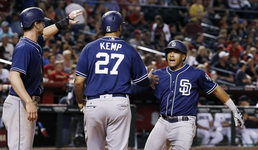 San Diego Padres' Yangervis Solarte, right, celebrates his three-run home run against the Arizona Diamondbacks with Matt Kemp (27) and Wil Myers, left, during the sixth inning of a baseball game Friday, May 27, 2016, in Phoenix. (AP Photo/Ross D. Franklin)