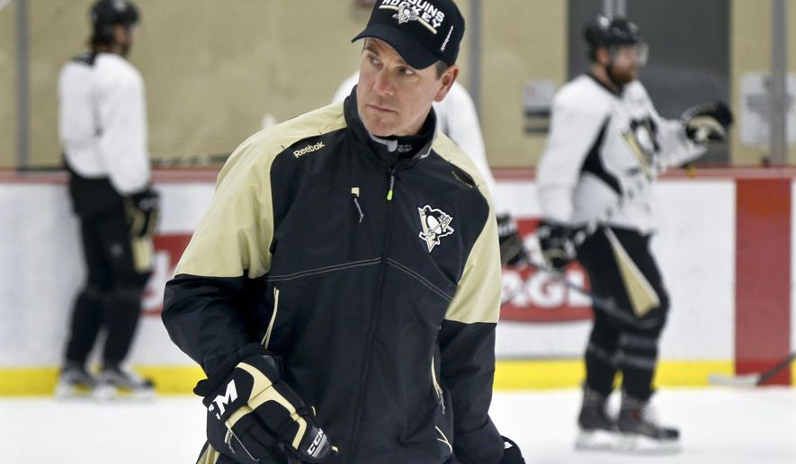 Pittsburgh Penguins head coach Mike Sullivan skates with the team during NHL hockey practice at the UPMC Lemieux Sports Complex, Saturday, May 28, 2016, in Cranberry, Pa. The Penguins host the San Jose Sharks in Game 1 of the Stanley Cup Finals on Monday, May 30. Mike Sullivan wasn't Rutherford's first choice to be the Pittsburgh Penguins coach. However, the duo have worked in lock step with Rutherford acquiring quick, skilled players to go with Sullivan's aggressive, pressure-heavy style which lead the franchise to a Stanley Cup appearance that appeared far-fetched when Sullivan was hired in December. (AP Photo/Keith Srakocic)