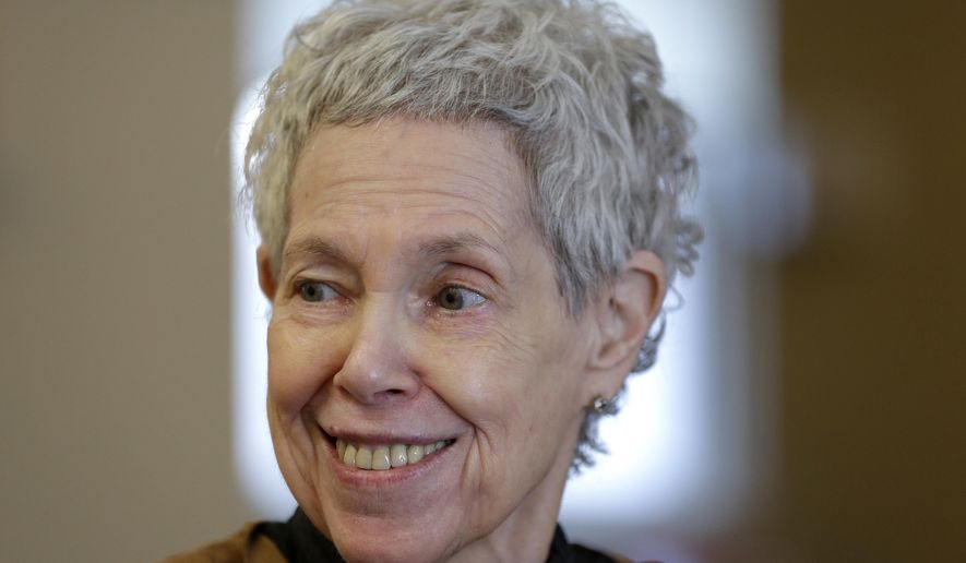 In this March 19, 2016 photo, Barbara Handschu talks to a reporters at her apartment in New York. Handschu barely gave it a thought 45 years ago when she was listed first among plaintiffs in a Vietnam-era lawsuit challenging how New York City police officers conducted surveillance of political activities. (AP Photo/Seth Wenig)