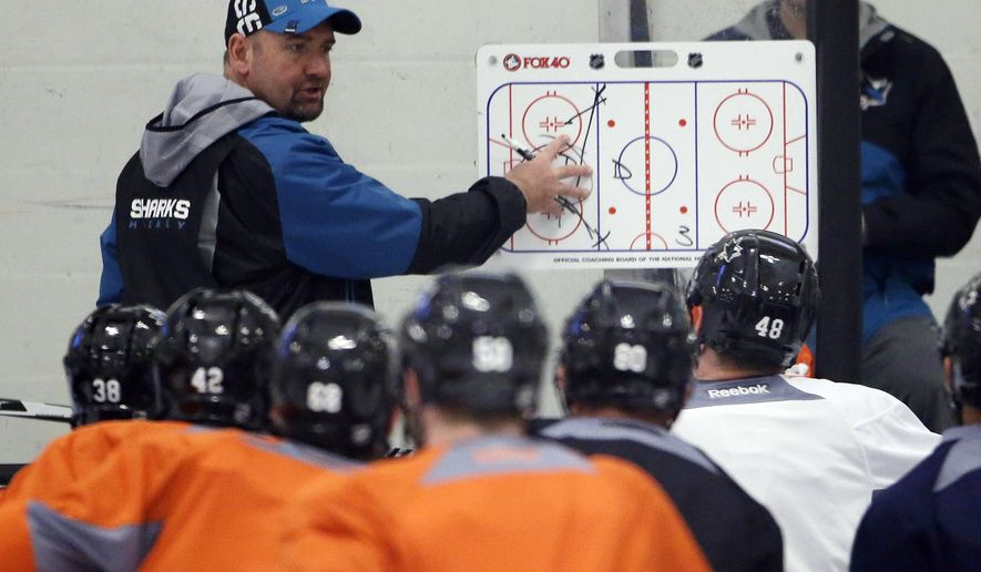 San Jose Sharks head coach Peter DeBoer, top, talks to his team during an NHL hockey practice Friday, May 27, 2016, in San Jose, Calif. San Jose will play Pittsburgh in the Stanley Cup Final. (AP Photo/Marcio Jose Sanchez)