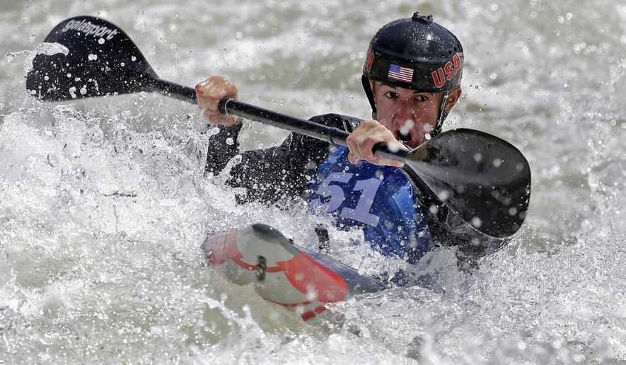 FILE - In this April 8, 2016, file phot, Michal Smolen paddles toward the finish line during the first day of the 2016 Slalom Olympic Team Trials for canoe and kayak in Charlotte, N.C. Born in Poland but living in the United States, the kayaker could've gone back to his native country for a chance to compete under its flag in London. Now 22, Smolen lives in Gastonia, N.C., and is considered a potential medalist in singles slalom kayaking, a potential first for his adopted country, the United States. (AP Photo/Chuck Burton, File)