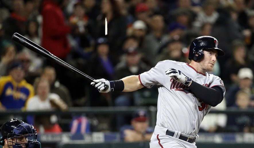 Minnesota Twins' Robbie Grossman splinters his bat on a two-run double against the Seattle Mariners in the third inning of a baseball game Friday, May 27, 2016, in Seattle. (AP Photo/Elaine Thompson)