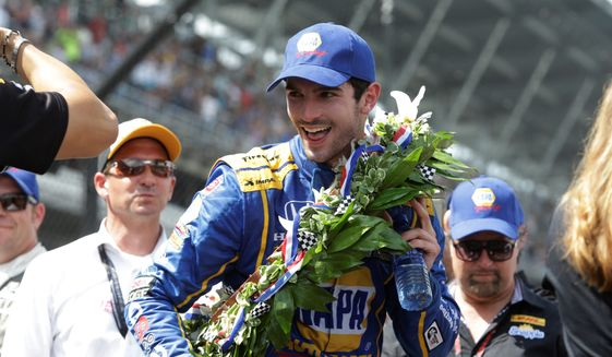 Alexander Rossi, a 24-year-old American, smiles after he won the 100th Indianapolis 500 on Sunday as a 66-to-1 long shot. (Associated Press)