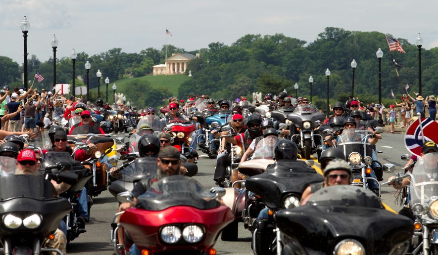 Thousands of participants parade over Arlington Memorial Bridge during Rolling Thunder's 29th annual ride in support the U.S. armed forces on Sunday. (Associated Press photographs)