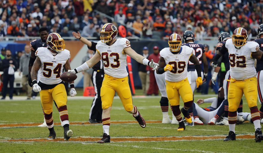 Washington Redskins outside linebacker Trent Murphy (93) celebrates after tackling Chicago Bears quarterback Jay Cutler for a sack and recovering a fumble during the first half of an NFL football game, Sunday, Dec. 13, 2015, in Chicago. (AP Photo/Charles Rex Arbogast)