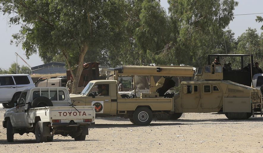 Iraqi security forces, with allied Shiite Popular Mobilization Forces and Sunni tribal fighters, gather ahead of an operation aimed at re-taking the Islamic State-held city of Fallujah, outside Fallujah, Iraq, Sunday, May 29, 2016. (AP Photo/Khalid Mohammed)