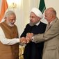 From left, Indian Prime Minister Narendra Modi, Iranian President Hassan Rouhani and Afghan President Ashraf Ghani hold hands in a show of solidarity after their trilateral meeting at the Saadabad Palace in Tehran, Iran, on May 23. (Iranian Presidency Office via Associated Press)