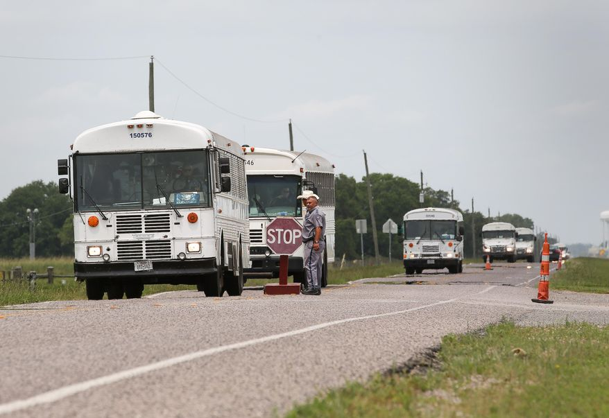 "Texas Department of Criminal Justice prisoners are evacuated from the Terrell and Stringfellow Units Sunday, May 29, 2016, in Rosharon, Texas. Heavy rains have caused flooding in the Brazos River and prompted prison officials to start evacuating about 2600 inmates. ""We're just trying to get ahead of it,"" Major Richard Babcock said.  (Jon Shapley/Houston Chronicle via AP)"