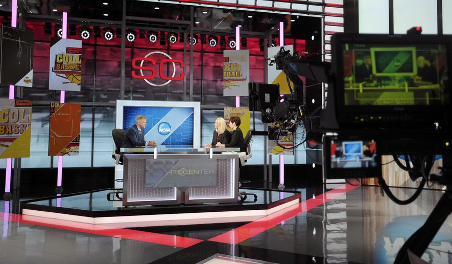 FILE -- In this Nov. 3, 2015 file photo, Notre Dame head coach Muffet McGraw, right, sits with Maryland head coach Brenda Frese for a live interview with sportscaster David Lloyd, left, on SportsCenter at ESPN in Bristol, Conn. About a decade after the state had high hopes of luring major movies, Connecticut is now actively courting the television and digital media industry, working to attract and grow companies that can meet the burgeoning demand for the content used across multiple platforms. (AP Photo/Jessica Hill, File)