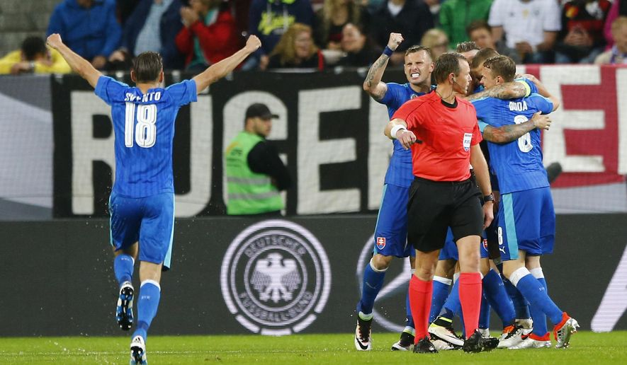 Slovakia players celebrate scoring their third goal during a friendly soccer match between Germany and Slovakia in Augsburg, Germany,  Sunday, May 29, 2016. (AP Photo/Matthias Schrader)