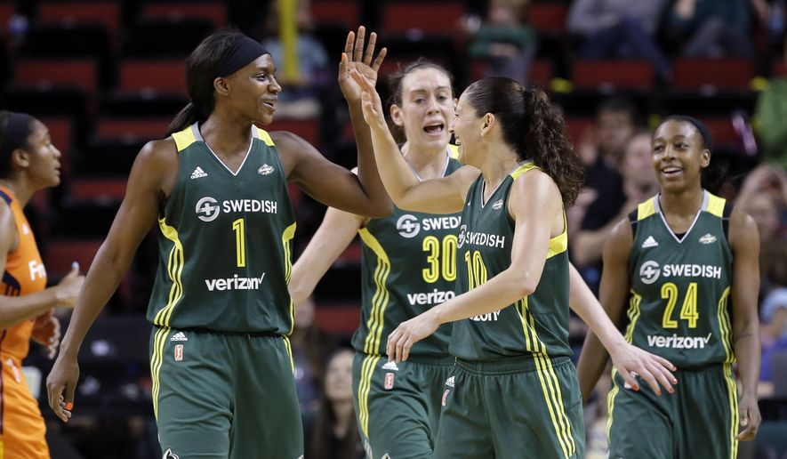 Seattle Storm's Crystal Langhorne (1) is greeted by Sue Bird (10) as Breanna Stewart (30) and Jewell Loyd (24) come up behind after the team increased its lead over the Connecticut Sun late in the second half of a WNBA basketball game Saturday, May 28, 2016, in Seattle. The Storm won 93-81. (AP Photo/Elaine Thompson)