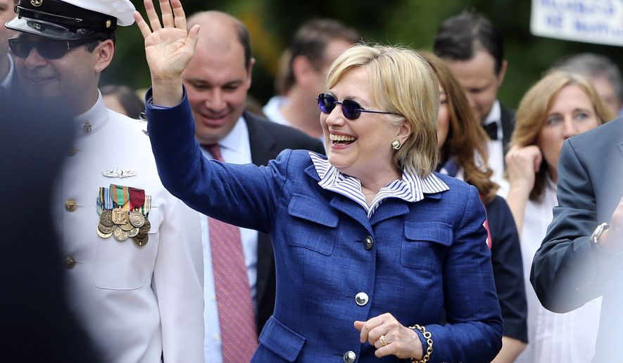 Democratic presidential candidate Hillary Clinton waves as she walks in a Memotial Day parade Monday, May 30, 2016, in Chappaqua, N.Y. (AP Photo/Mel Evans)