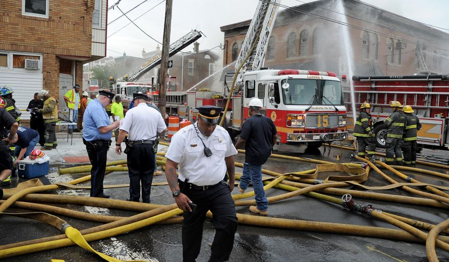 Philadelphia firefighters work to put out a fire at the American Legion Post 396, Monday May 30, 2016, in Philadelphia. There were no reports of injuries. (Tom Gralish/The Philadelphia Inquirer via AP)  PHIX OUT; TV OUT; MAGS OUT; NEWARK OUT; MANDATORY CREDIT