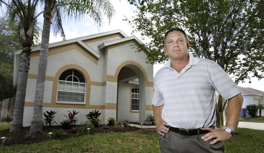 In this photo taken May 23, 2016, Kevin Byrne, a manager with RE-710, poses in front of a Valrico, Fla., home his company recently bought, fixed up and is now renting out.  (James Borchuck/The Tampa Bay Times via AP)  TAMPA OUT; CITRUS COUNTY OUT; PORT CHARLOTTE OUT; BROOKSVILLE HERNANDO TODAY OUT; MANDATORY CREDIT