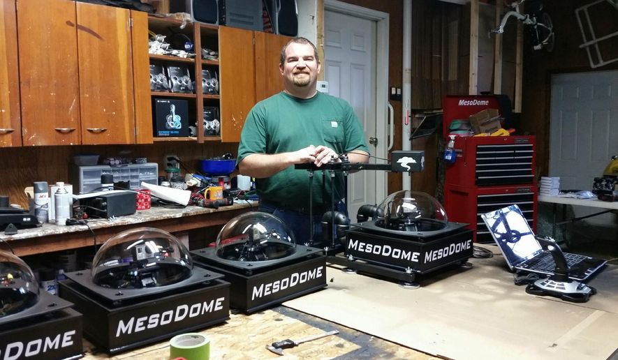 In this May 4, 2016 photo, Brad Emel, who has nearly 20 years of experience as a storm spotter, is shown with some of his MesoDome storm chasing video devices at his home in rural Sullivan, Ill. Emil developed a passion and interest in storms at the age of 16 with the Emergency Service Disaster Agency in Sullivan. Today, he is a trained spotter with the National Weather Service. (Dawn James/Journal Gazette via AP) MANDATORY CREDIT