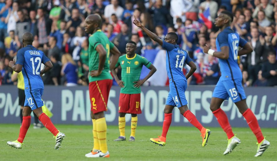 France's Blaise Matuidi, second right, celebrates with teammates after scoring the first goal during a friendly soccer match between France and Cameroon at the La Beaujoire Stadium in Nantes, western France, Monday, May 30, 2016. The French squad is in preparation for the EURO 2016 soccer championships which will start on June 10, 2016. (AP Photo/David Vincent)
