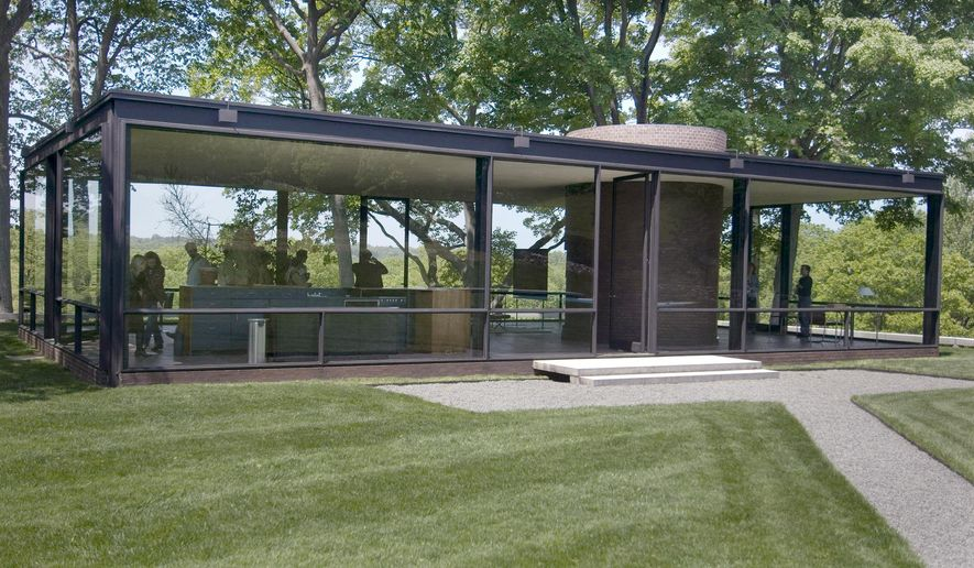 FILE - This May 23, 2007 file photo shows an exterior view of the Glass House in New Canaan, Conn. A May 12, 2016 approval from the local zoning board allows the Modernist landmark, designed in 1949 by the late architect Philip Johnson, to hold more events with small crowds and raises the cap on attendance for its annual fundraiser. (AP Photo/Douglas Healey, File)