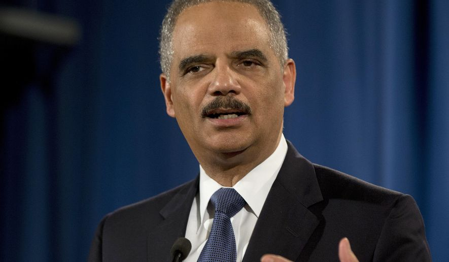 "FILE - In this March 4, 2015, file photo, then-Attorney General Eric Holder speaks at the Justice Department in Washington. Holder says Edward Snowden performed a ""public service"" in stoking a national debate about secret domestic surveillance programs, but that he should still return to the U.S. to stand trial. Holder spoke with CNN political commentator David Axelrod in a podcast released May 30, 2016. (AP Photo/Carolyn Kaster)"