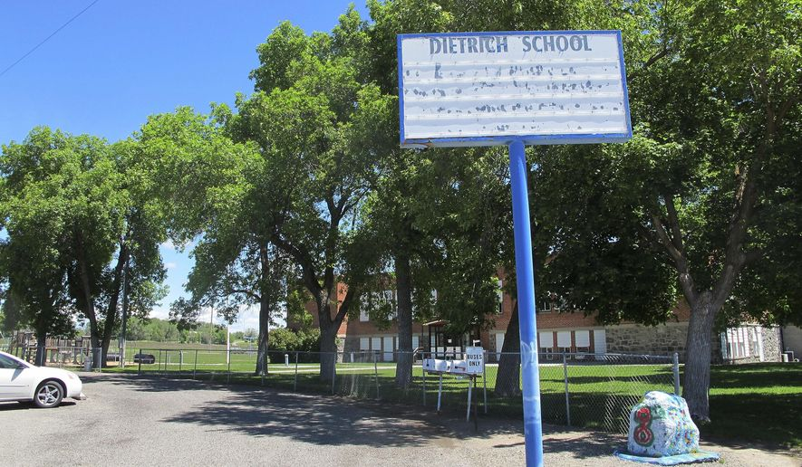 In this Thursday, May 26, 2016 photo, an empty school reader board stands in front of the only school building in Dietrich, Idaho. The small community is struggling with the national attention brought by reports that a disabled black football player was raped by his white high school teammates. The allegations of racist taunts and physical abuse suffered by the teen were revealed this month when the family filed a $10 million lawsuit against the Dietrich School District.  (AP Photo/Kimberlee Kruesi)