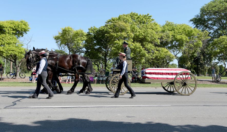 A military funeral cortege is shown in this file photo via the Detroit Free Press (Jessica J. Trevino/Detroit Free Press via AP)  DETROIT NEWS OUT; TV OUT; MAGAZINES OUT; NO SALES; MANDATORY CREDIT DETROIT FREE PRESS **FILE**