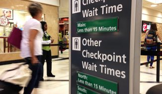 Airline passengers enter the main security checkpoint at Hartsfield-Jackson International Airport in Atlanta on Monday, May 30, 2016. Travelers who had braced for long lines and long waits were instead moving through most U.S. airports fairly quickly Monday, as the busy Memorial Day travel weekend drew to a close. (AP Photo/Kathleen Foody)