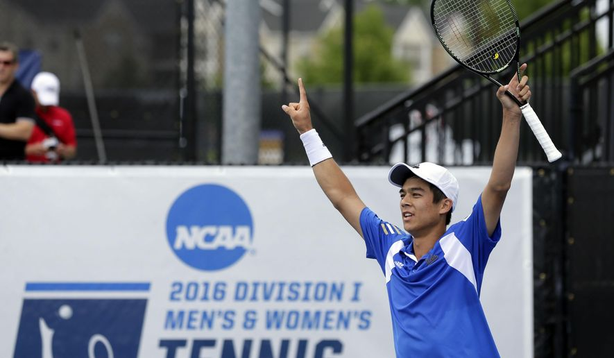 Mackenzie McDonald, of UCLA, raises his racquet during against Mikael Torpegaard, of Ohio State, in the final of the NCAA Division I men's tennis national championship in Tulsa, Okla., Monday, May 30, 2016. McDonald upset top-seeded Torpegaard, 6-3, 6-3. (Cory Young/Tulsa World via AP) MANDATORY CREDIT
