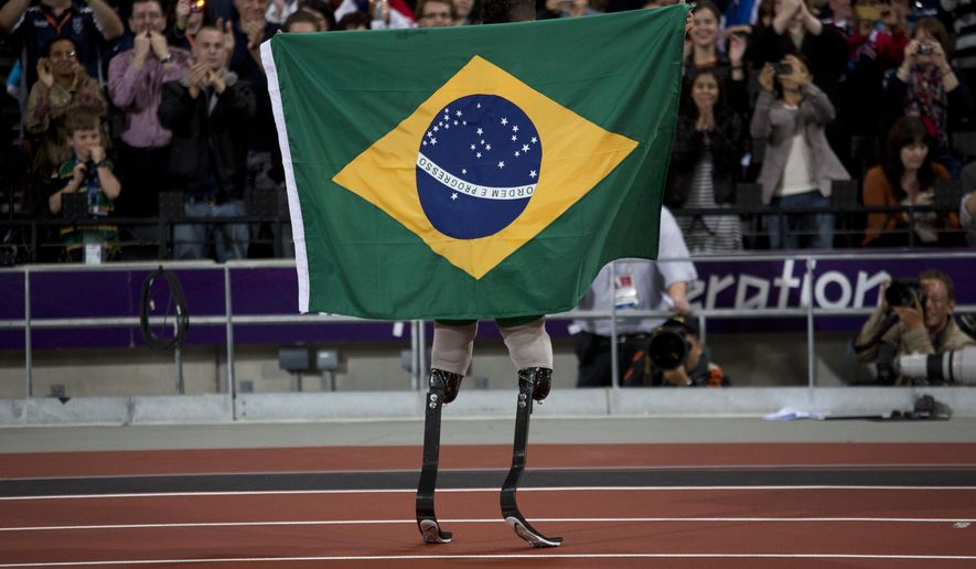 FILE.- In this Sept. 2, 2012 file photo Brazil's Alan Fonteles Cardoso Oliveira celebrates after winning the Men's 200m T44 final at the 2012 London Paralympics.  The countdown clock for the Paralympic Games in Rio de Janeiro reaches 100 days on Monday with about 4,300 athletes participating, far fewer than the 10,500 in the Olympics. The Paralympic Games open Sept. 7.(AP Photo/Emilio Morenatti,File)