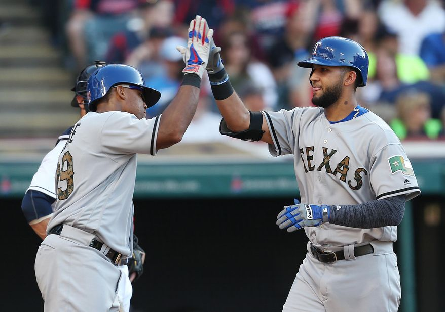Texas Rangers' Nomar Mazara, right, celebrates with Adrian Beltre after hitting a three run home run off Cleveland Indians relief pitcher Austin Adams during the fourth inning of a baseball game Monday, May 30, 2016, in Cleveland. (AP Photo/Ron Schwane)