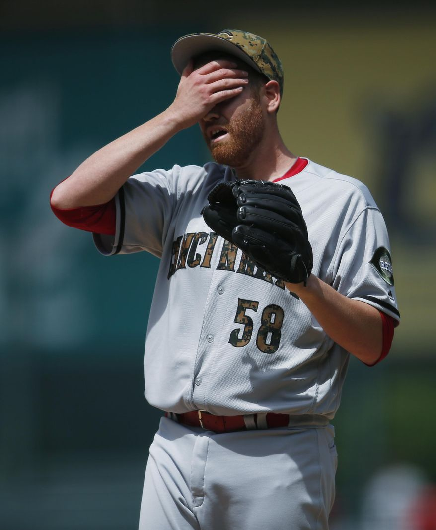 Cincinnati Reds starting pitcher Dan Straily reacts after giving up a leadoff, solo home run to Colorado Rockies Charlie Blackmon in the first inning of a baseball game Monday, May 30, 2016, in Denver. (AP Photo/David Zalubowski)