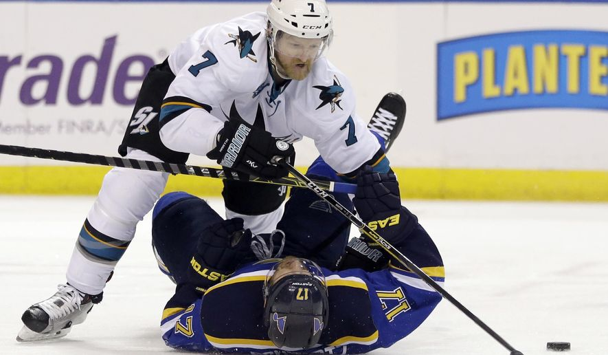 In this Monday, May 23, 2016 file photo, San Jose Sharks defenseman Paul Martin (7) chases the puck against St. Louis Blues left wing Jaden Schwartz (17) during the second period in Game 5 of the NHL hockey Stanley Cup Western Conference finals in St. Louis. Martin and the Sharks will be playing the Pittsburgh Penguins, for whom Martin played for five seasons, in the Stanley Cup finals. (AP Photo/Jeff Roberson, File)