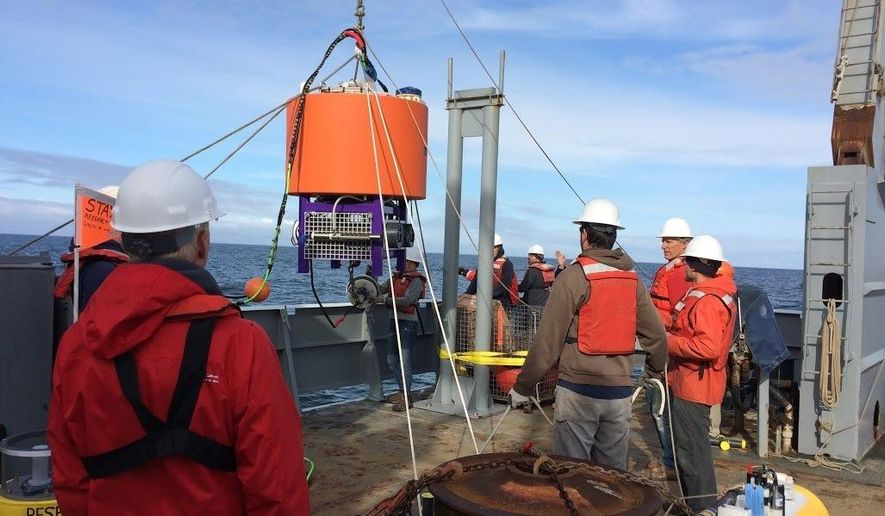 "In this May 23, 2016, photo provided by NOAA Northwest Fisheries, an automated laboratory that will analyze seawater for algae species and toxins is lowered by researchers into the Pacific about 13 miles from La Push, Wash. After a massive toxic algae bloom closed lucrative shellfish fisheries off the West Coast last year, scientists are now turning to the new tool, dubbed ""a laboratory in a can, that could provide early warning of future problems. It is expected to provide real-time data on concentrations of six species of microscopic algae and toxins they produce, including domoic acid. (Stephanie Moore, NOAA via AP)"
