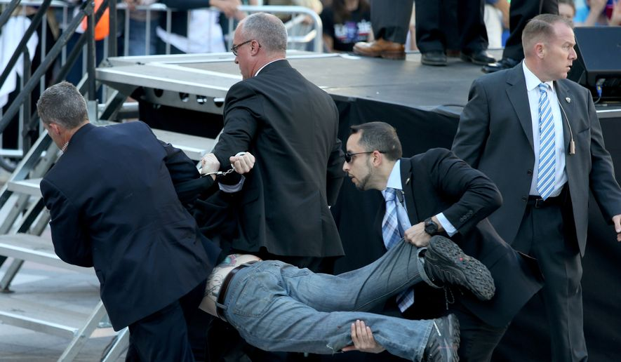 Secret Service agents remove a man from the crowd during a campaign rally for Democratic presidential candidate, Sen. Bernie Sanders, I-Vt., at Frank Ogawa Plaza in Oakland, Calif., on Monday, May 30, 2016. (Anda Chu/Oakland Tribune via AP)