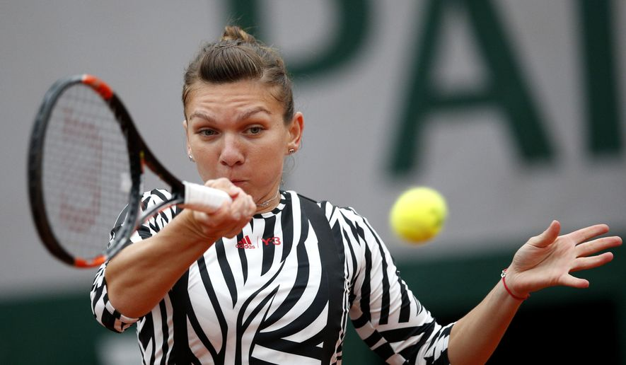 Romania's Simona Halep returns the ball to Australia's Samantha Stosur during their fourth round match of the French Open tennis tournament at the Roland Garros stadium, Sunday, May 29, 2016 in Paris.  (AP Photo/Christophe Ena)