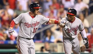 Washington Nationals' Stephen Drew (10) is cheered by Ben Revere (9) after scoring on an inside-the-park home run off Philadelphia Phillies relief pitcher Colton Murray during the ninth inning of a baseball game, Tuesday, May 31, 2016, in Philadelphia. The Nationals won 5-1. (AP Photo/Laurence Kesterson)