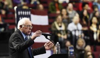 In this March 25, 2016, file photo, Democratic presidential candidate Bernie Sanders, I-Vt., addresses the crowd during a rally at the Moda Center in Portland, Ore. (AP Photo/Steve Dykes, File)