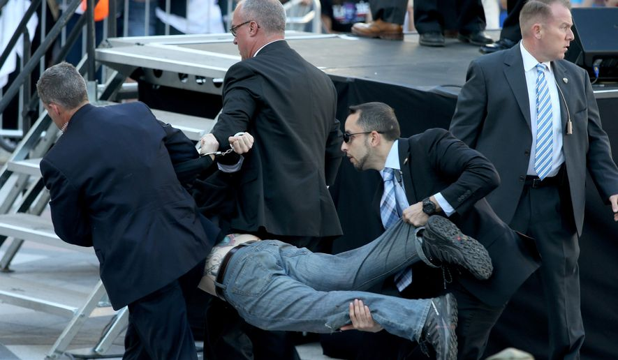 Secret Service agents remove a man from the crowd during a campaign rally for Democratic presidential candidate, Sen. Bernie Sanders, I-Vt., at Frank Ogawa Plaza in Oakland, Calif., on Monday, May 30, 2016. A group of animal rights activists briefly interrupted the Sanders rally in Northern California when they jumped barricades and tried to rush the podium. (Anda Chu/Oakland Tribune via AP)