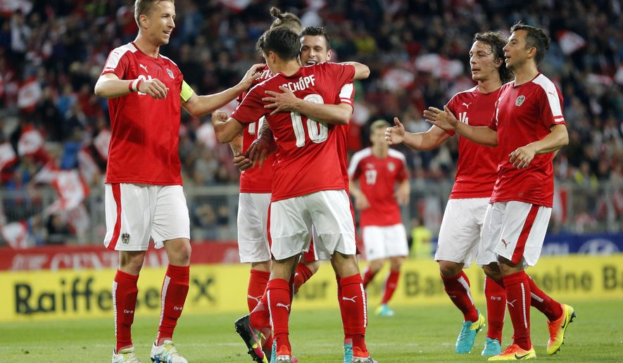 Austria players celebrate their second goal during the international friendly soccer match between Austria and Malta, in Klagenfurt, Austria, Tuesday, May 31, 2016. (AP Photo/Darko Bandic)
