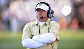 FILE - In this Oct. 30, 2010, file photo, Wake Forest head coach Jim Grobe watches from the sidelines during an NCAA college football game against Maryland in College Park, Md. Those who have worked and played for the new Baylor coach, say he believes in tough love, a hands-on approach and truly not putting winning above all.  (AP Photo/Nick Wass, File)