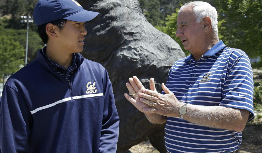 FILE - In this May 23, 2013, file photo, University of California's Michael Kim, left, speaks with golf coach Steve Desimone in Berkeley, Calif. The 67-year-old capped his career on Monday evening, May 30, 2016, when Cal bowed out of the NCAA tournament at Eugene Country Club in Oregon. (AP Photo/Ben Margot, File)