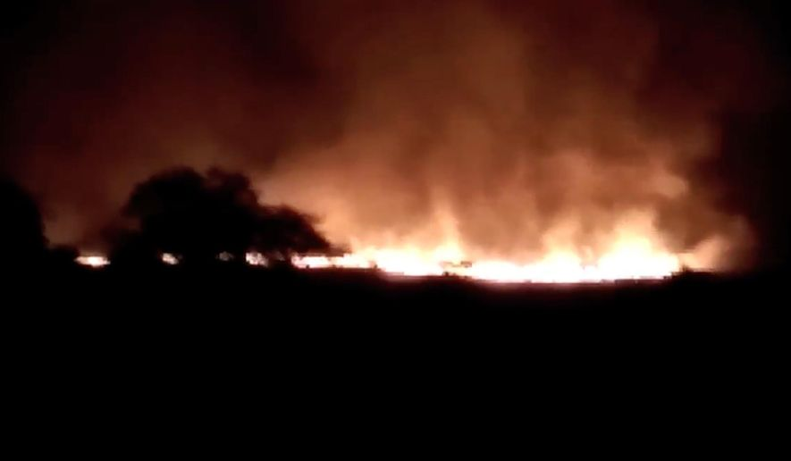 In this image made from video of K.K.Productions, a huge fire is seen at the Pulgaon ammunition depot in Pulgaon in the Indian state of Maharastra, Tuesday, May 31, 2016. A fire broke out at a major ammunitions depot in western India early Tuesday, causing fatalities, officials said.  (K.K. Productions via AP) NO SALES