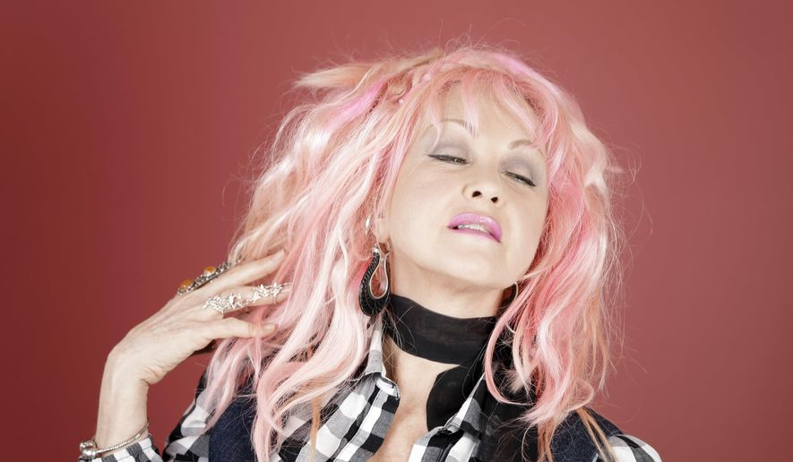 "In this March 14, 2016, photo, Cyndi Lauper poses in Nashville, Tenn., to promote her new country album, ""Detour,"" releasing on Friday, May 6. (AP Photo/Mark Humphrey)"