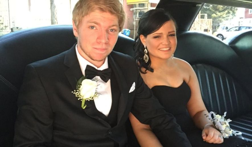 This May 26, 2016 image released by Barbara Darois shows Jessica Casanova, 17, right, holding hands with her prom date Nathan Cohen in Buffalo, N.Y. Casanova wore the black Badgley Mischka gown that actress Gina Rodriguez wore to the 2015 Golden Globe Awards.  (Barbara Darois via AP)