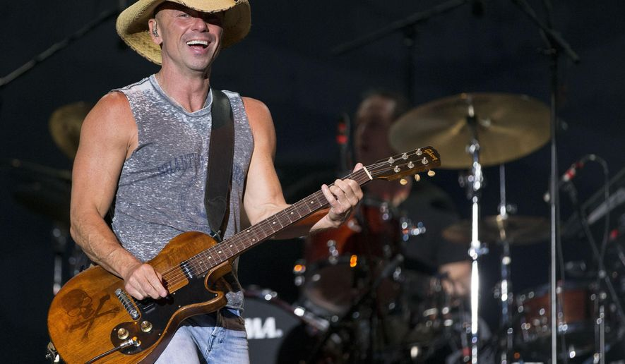 FILE - In this April 3, 2016 file photo, Kenny Chesney performs at the 4th Annual ACM Party for a Cause Festival in Las Vegas. hesney will headline a concert at Bristol Motor Speedway on Sept. 9, the night before the speedway hosts a football game between Tennessee and Virginia Tech. (Photo by Eric Jamison/Invision/AP, File)