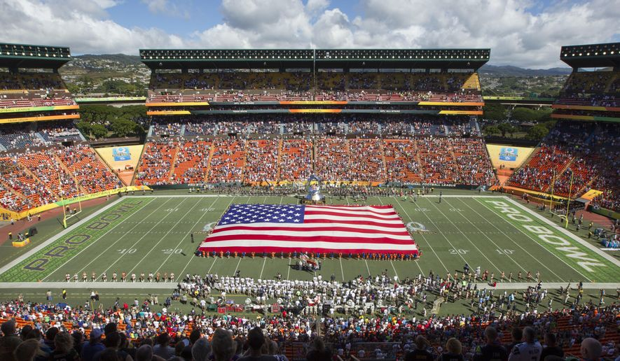 FILE In this Jan. 31, 2016, file photo, an American flag is displayed while fans sing the national anthem before the NFL Pro Bowl football game in Honolulu, Hawaii. Losing the NFL's Pro Bowl to Orlando is a sign Hawaii needs to compete harder, said state Rep. Tom Brower, the chairman of the tourism committee in the state House of Representatives. The game is important to the tourism industry for the exposure it gives the state and for the people it brings to Hawaii, Brower said and it stings to lose the revenue. (AP Photo/Eugene Tanner, File)