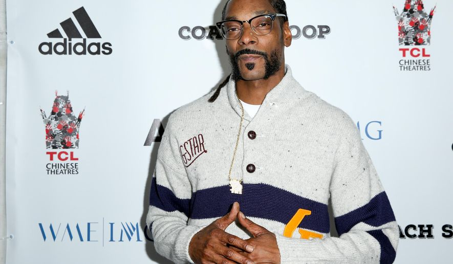 """FILE - In this, May 16, 2016, file photo, Snoop Dogg arrives at the LA Premiere of """"Coach Snoop"""" at the TCL Chinese 6 Theatres in Los Angeles. Snoop Dogg called for a boycott of the History Channel's """"Roots"""" remake in an Instagram post on May 30, 2016. (Photo by Rich Fury/Invision/AP, File)"""
